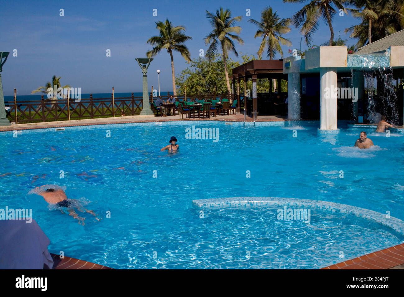 Hotel pool with people  People in the Hyatt hotel swimming pool in the Bay of Oman in Muscat ...