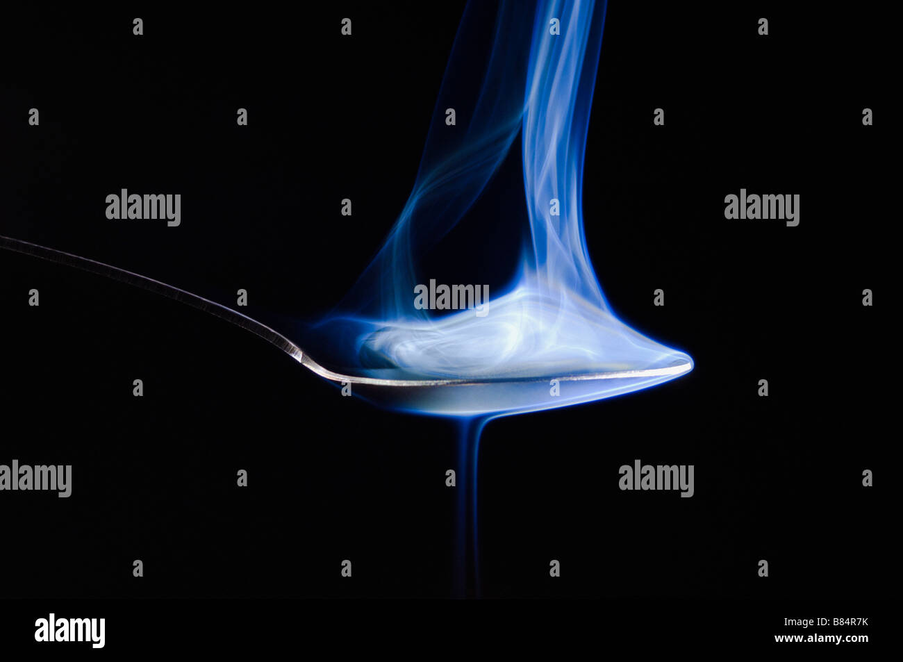 Smoke rising from a spoon - Stock Image