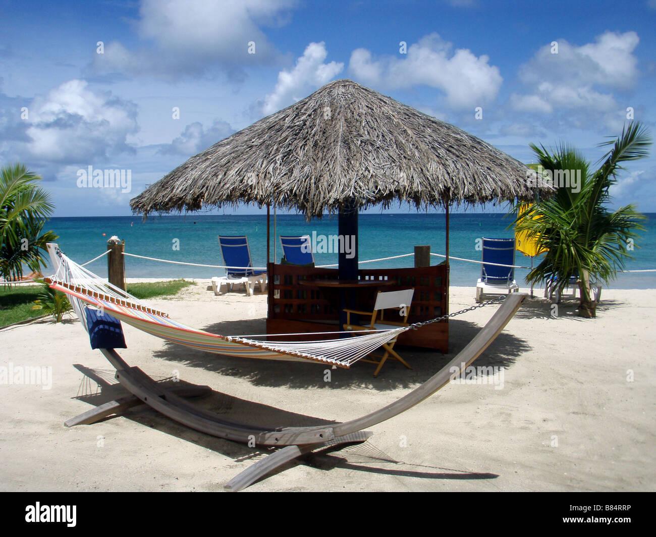 Hammock and Sun Loungers on Grand Anse Beach in the Caribbean Island of Grenada - Stock Image