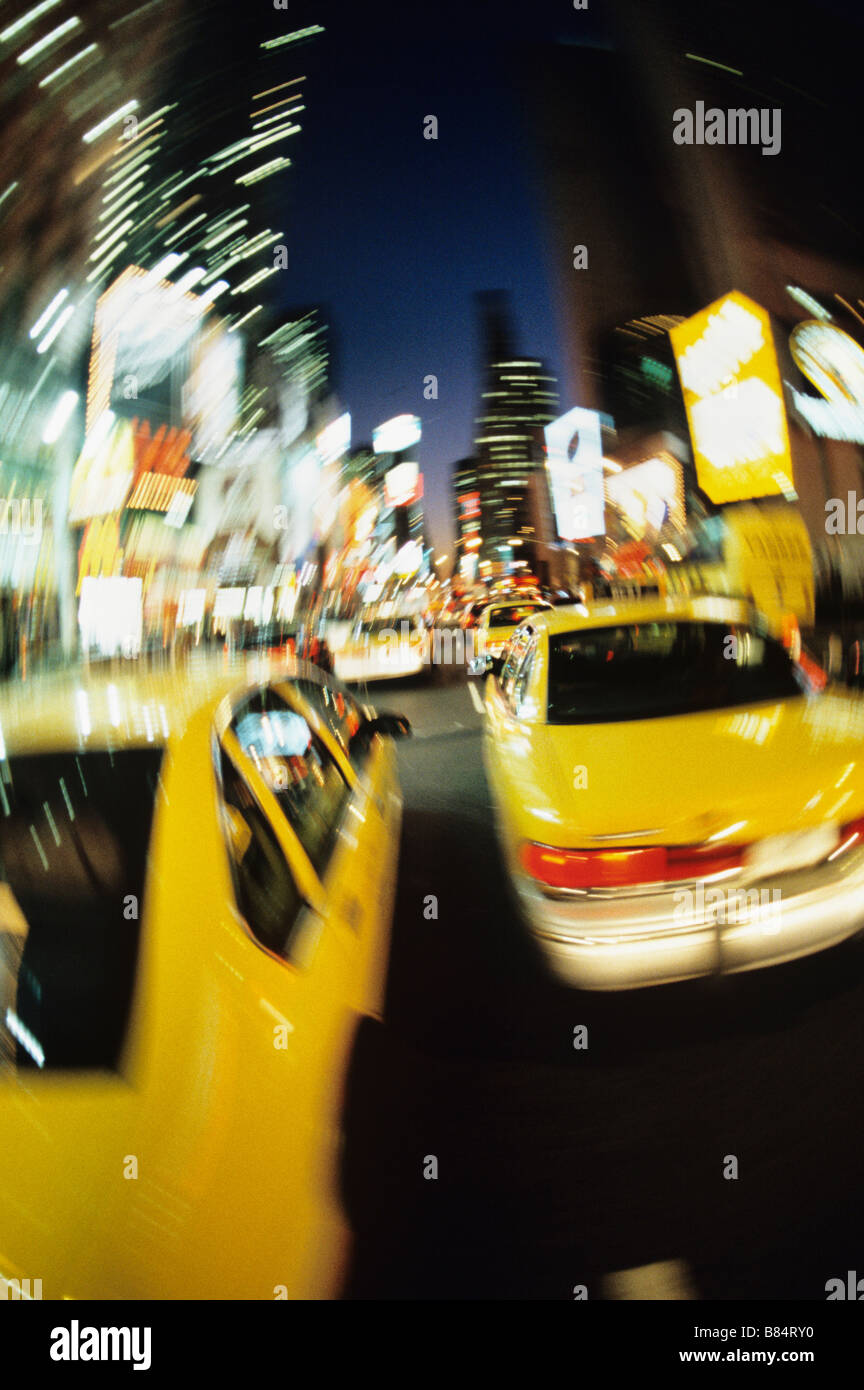 New York City, Times Square, Cabs in motion at night - Stock Image