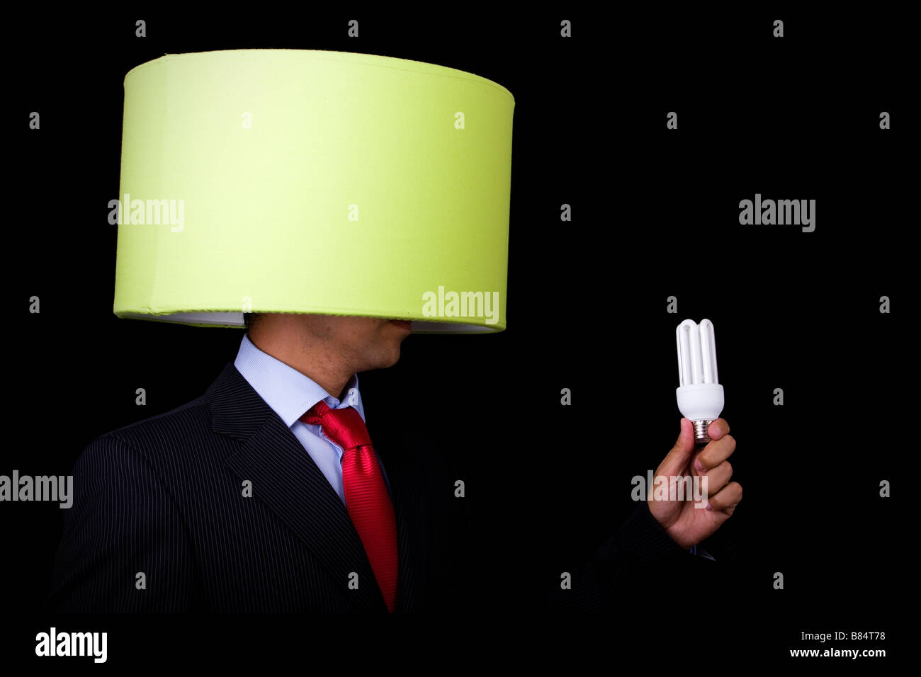 businessman holding a lamp it s not his idea - Stock Image