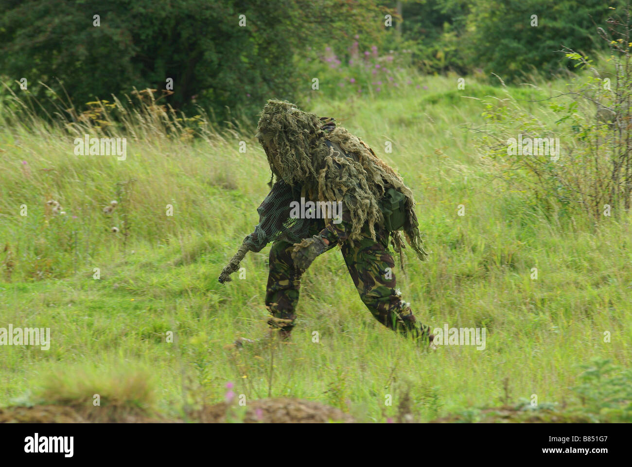 Sniper in Ghillie suit - Stock Image