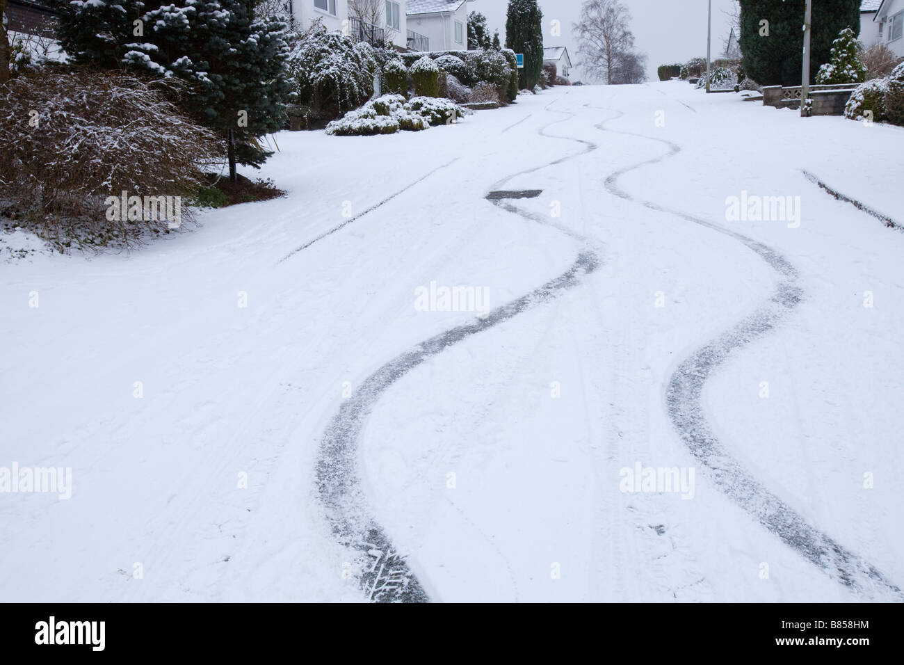 Skid marks in the snow from a car on a steep road in Ambleside UK