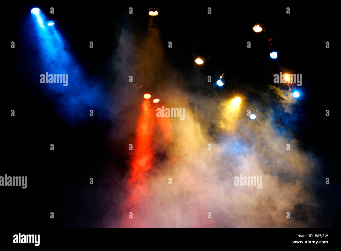 ray beam radiate stage set scene scenery searchlight spotlight multicolor entertaining excite blur blurred blurry - Stock Image
