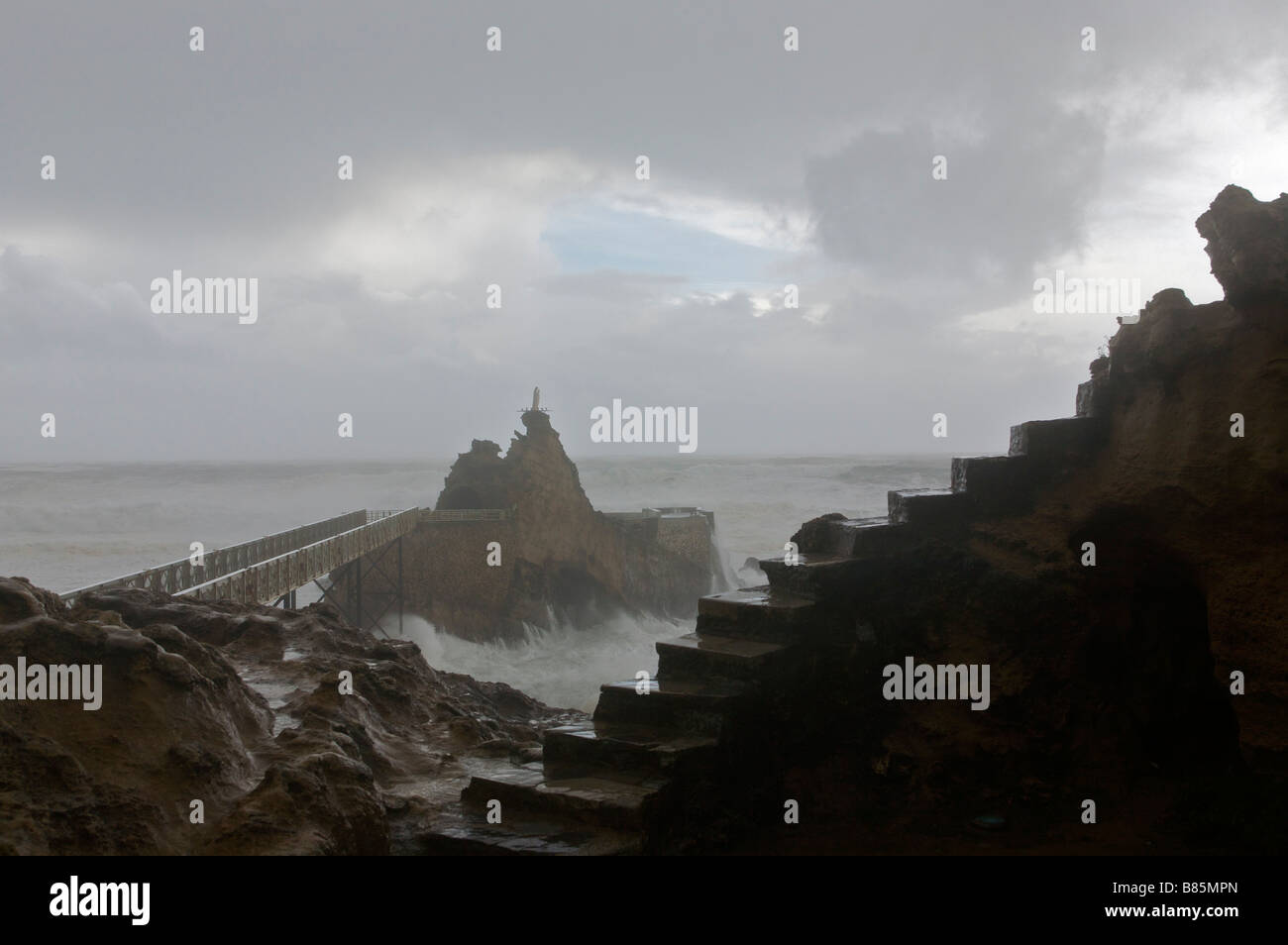 24 january 2009 KLaus storm in Biarritz Rock of the virgin in the middle of waves Pays Basque France Stock Photo