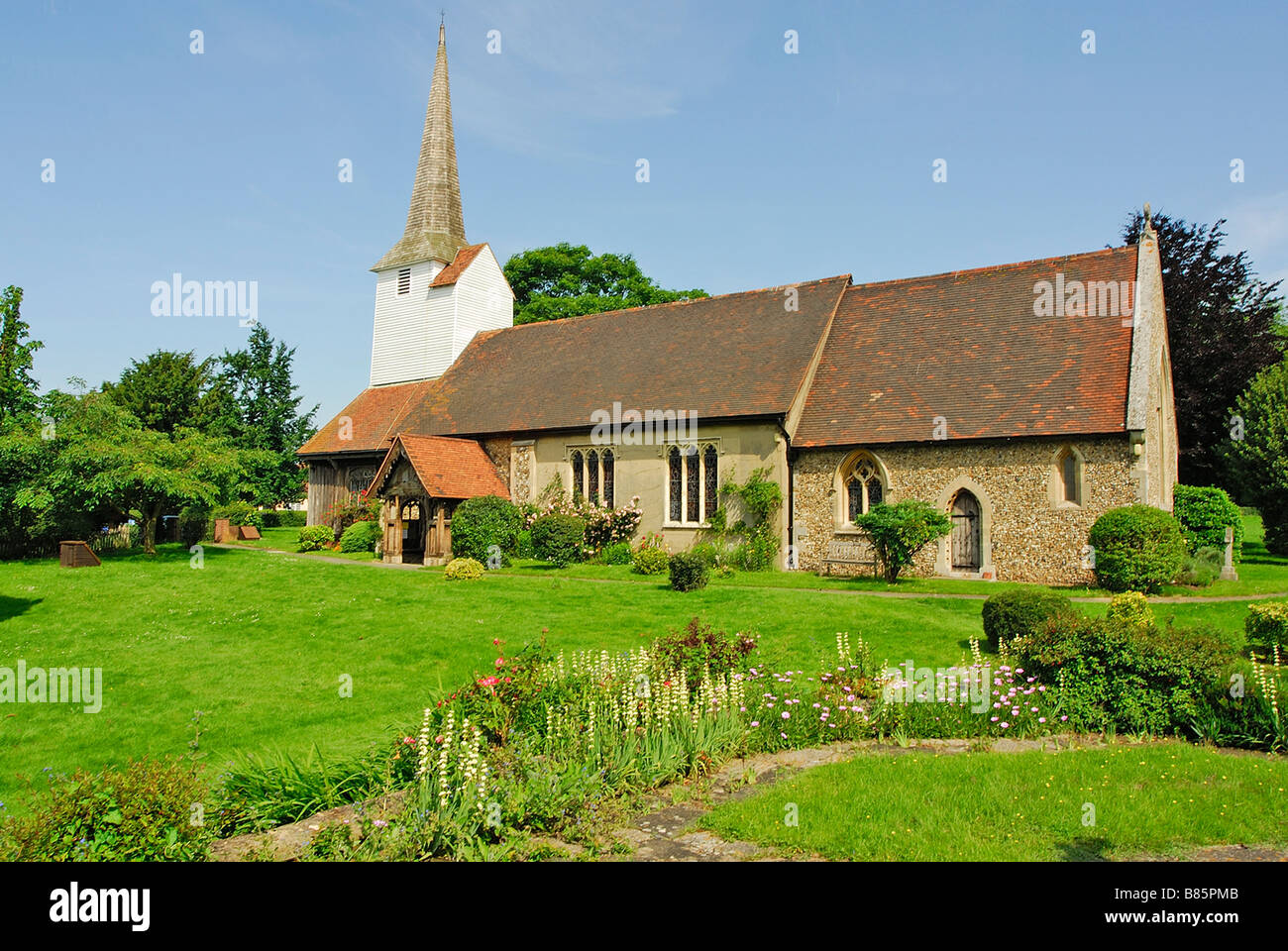All Saints church Stock Harvard Essex UK - Stock Image