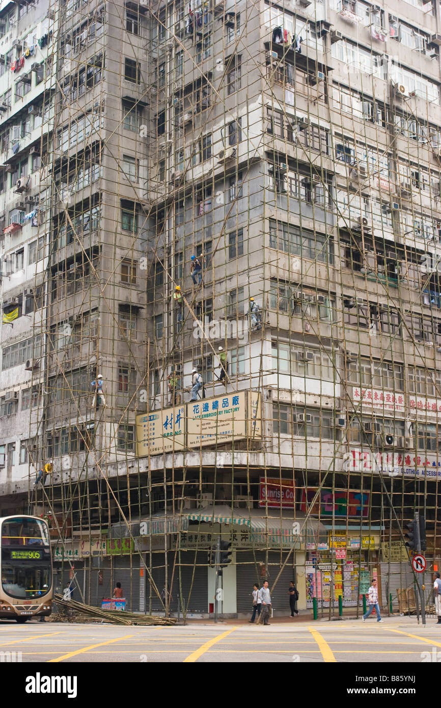 Bamboo scaffloding on a Hong Kong building - Stock Image