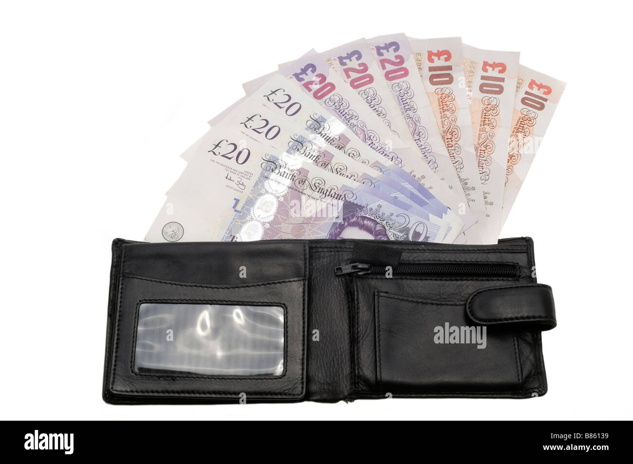 Mans black wallet spilling 10 and 20 notes.  Editorial use only - Stock Image