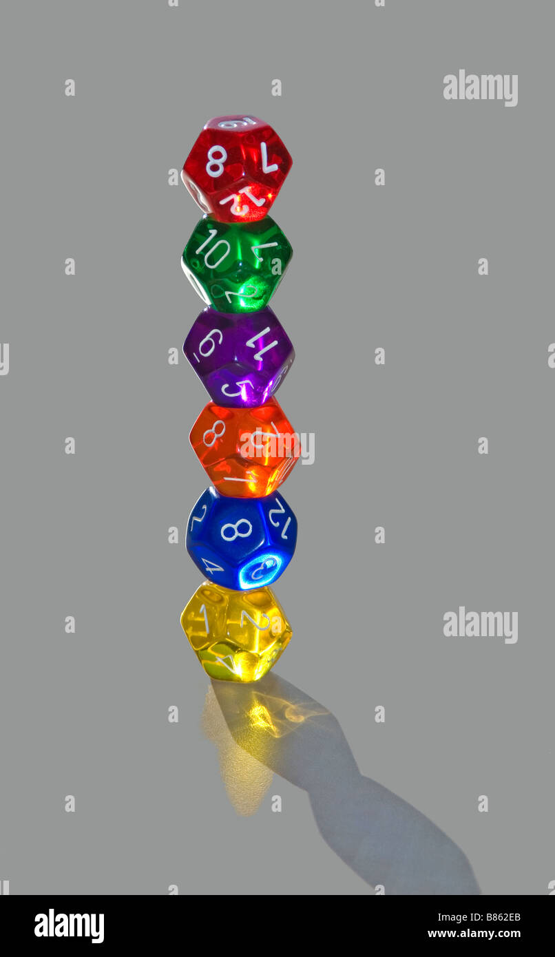 stack of six multi colored twelve sided dice - Stock Image
