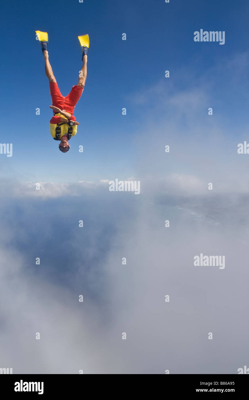 Skydiver is scuba-diving into the deep blue sea from the