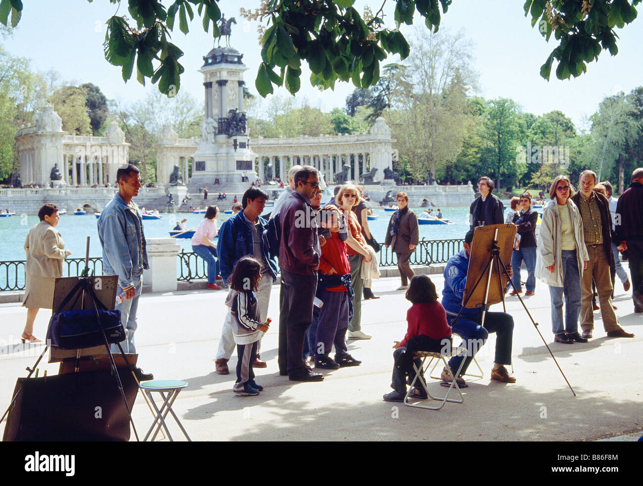 Group of people looking at drawer working. The Retiro park. Madrid. Spain. - Stock Image