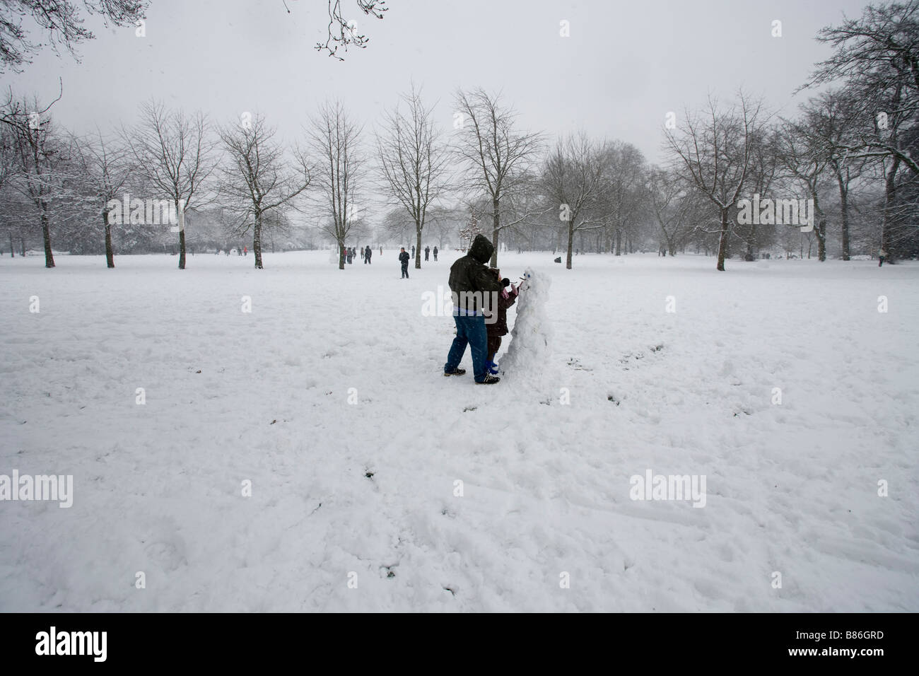 park snow snow men snow snow ball fights - Stock Image