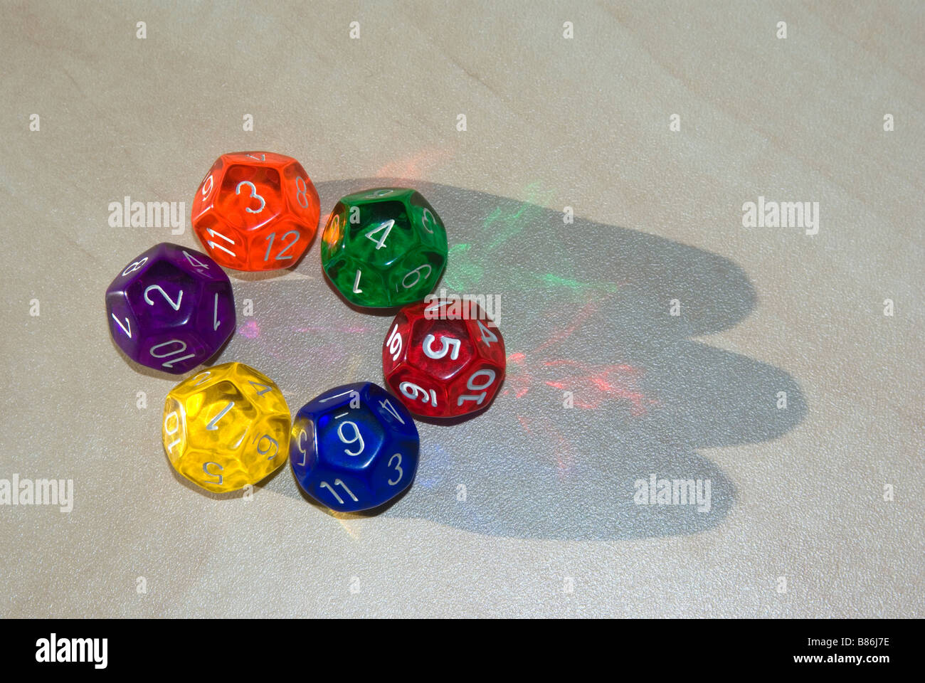 multi colored twelve sided dice - Stock Image