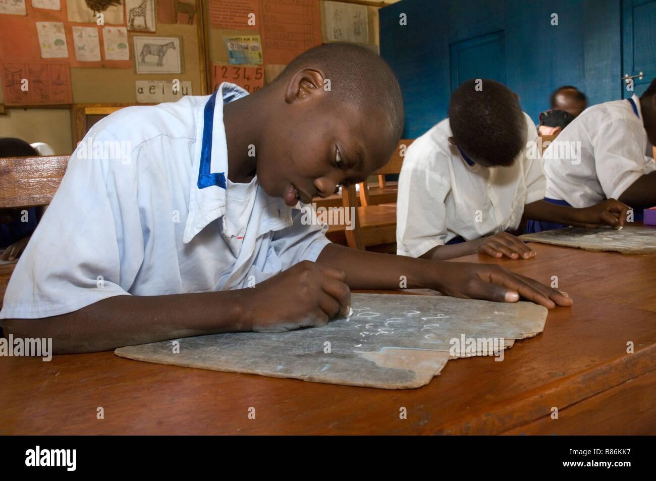 Children with intellectual disabilities writing in school, Mabogini, Kilimanjaro Region,  Tanzania Stock Photo