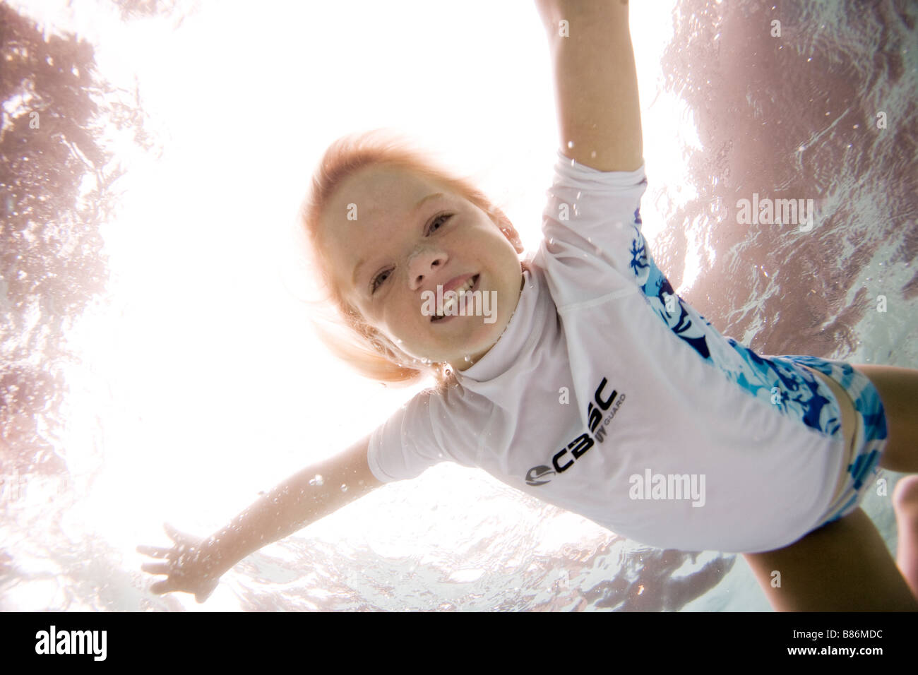 child swimming in pool - Stock Image