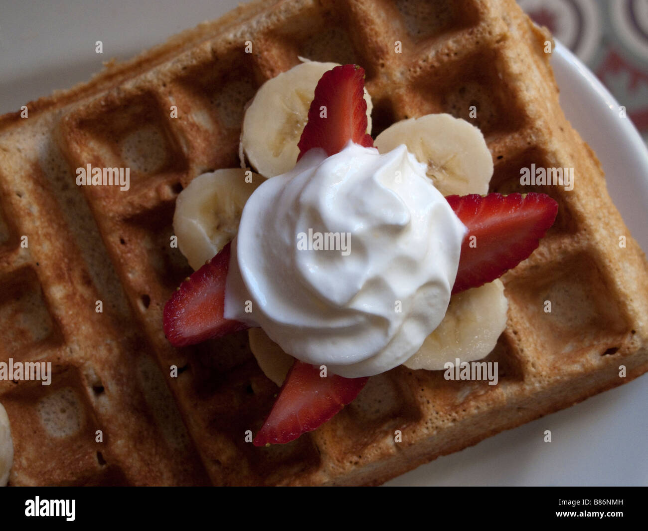 a delicious Mexican version of the Belgian (American) waffle made in a Oaxaca City cafe, Oaxaca, Mexico - Stock Image