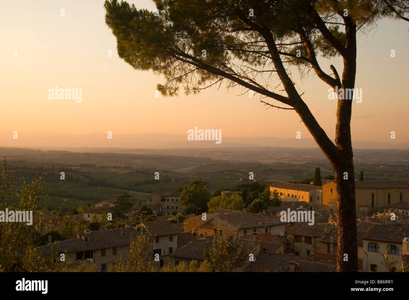 A view of the sun-drenched hills and sky of Tuscany, Italy, from the medieval town of San Gimignano. - Stock Image