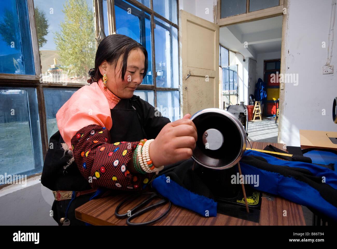 Tibetan woman taking sewing classes. Stock Photo