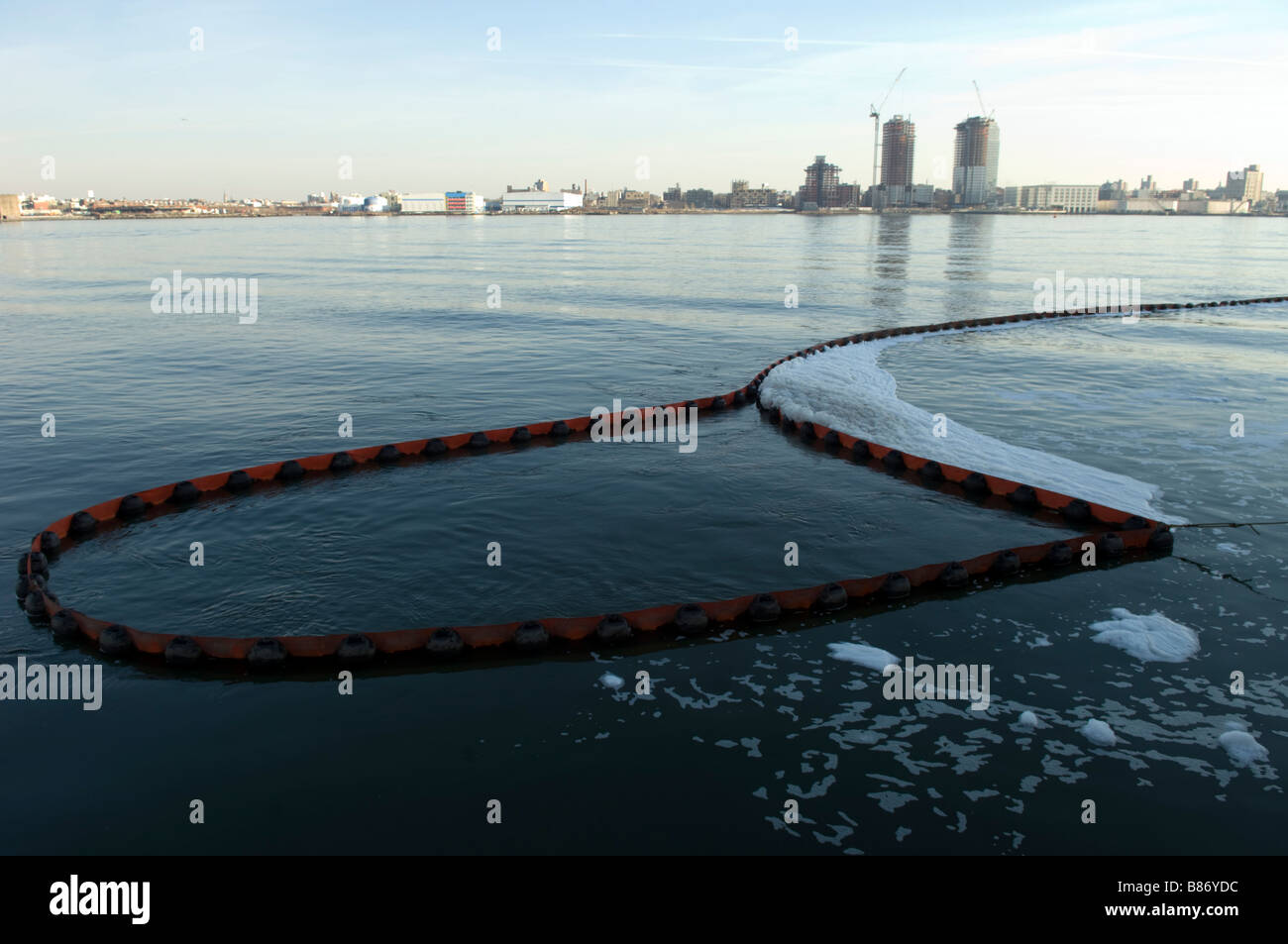 A boom to contain material from flowing into the East River in New York on Saturday February 7 2009 Frances M Roberts - Stock Image