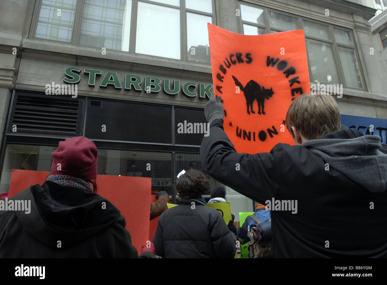 Starbucks workers and supporters protest Starbucks alleged anti union activity in New York - Stock Image