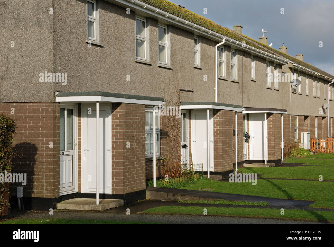 a row of council houses in kirkby, liverpool, uk - Stock Image