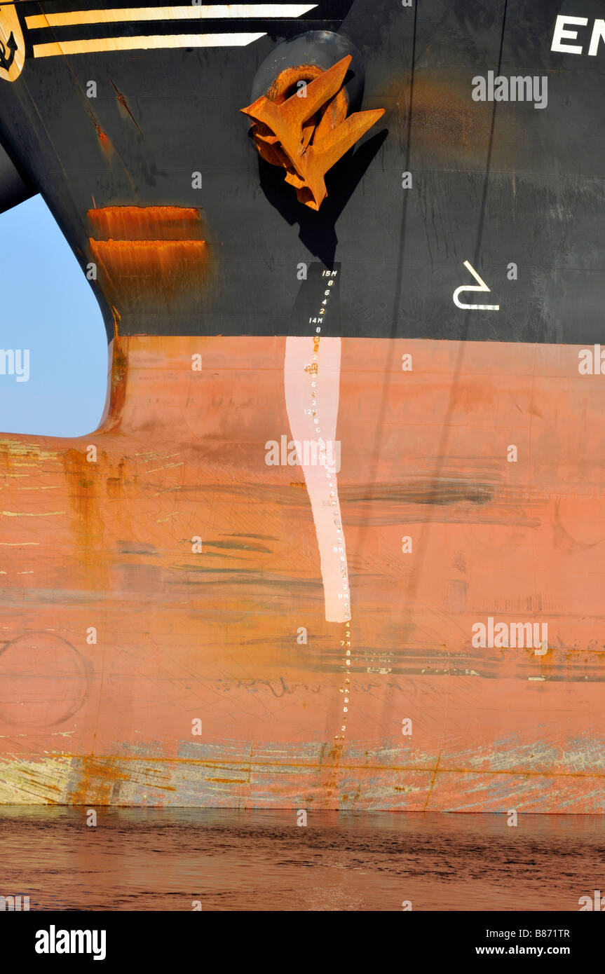 Bow of ship showing [rusty anchor howser] waterline and depth markings - Stock Image