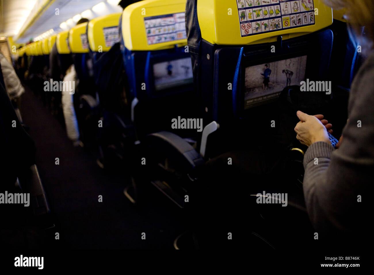 A passenger on a Ryanair flight. - Stock Image