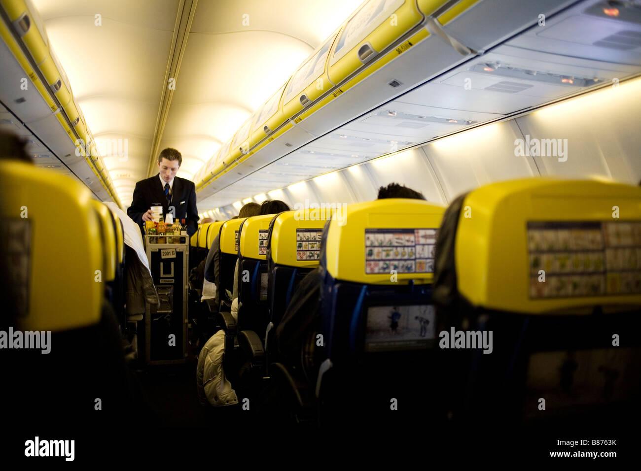 Service on a Ryanair flight. - Stock Image