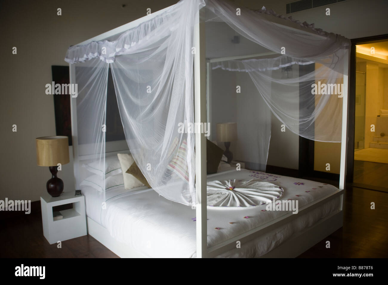 Four post bed in hotel with mosquito net Sri Lanka 3697 - Stock Image
