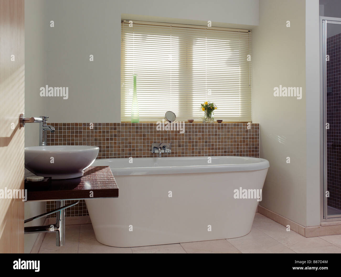 Modern Neutral Bathroom With Stand Alone Bath And Sink
