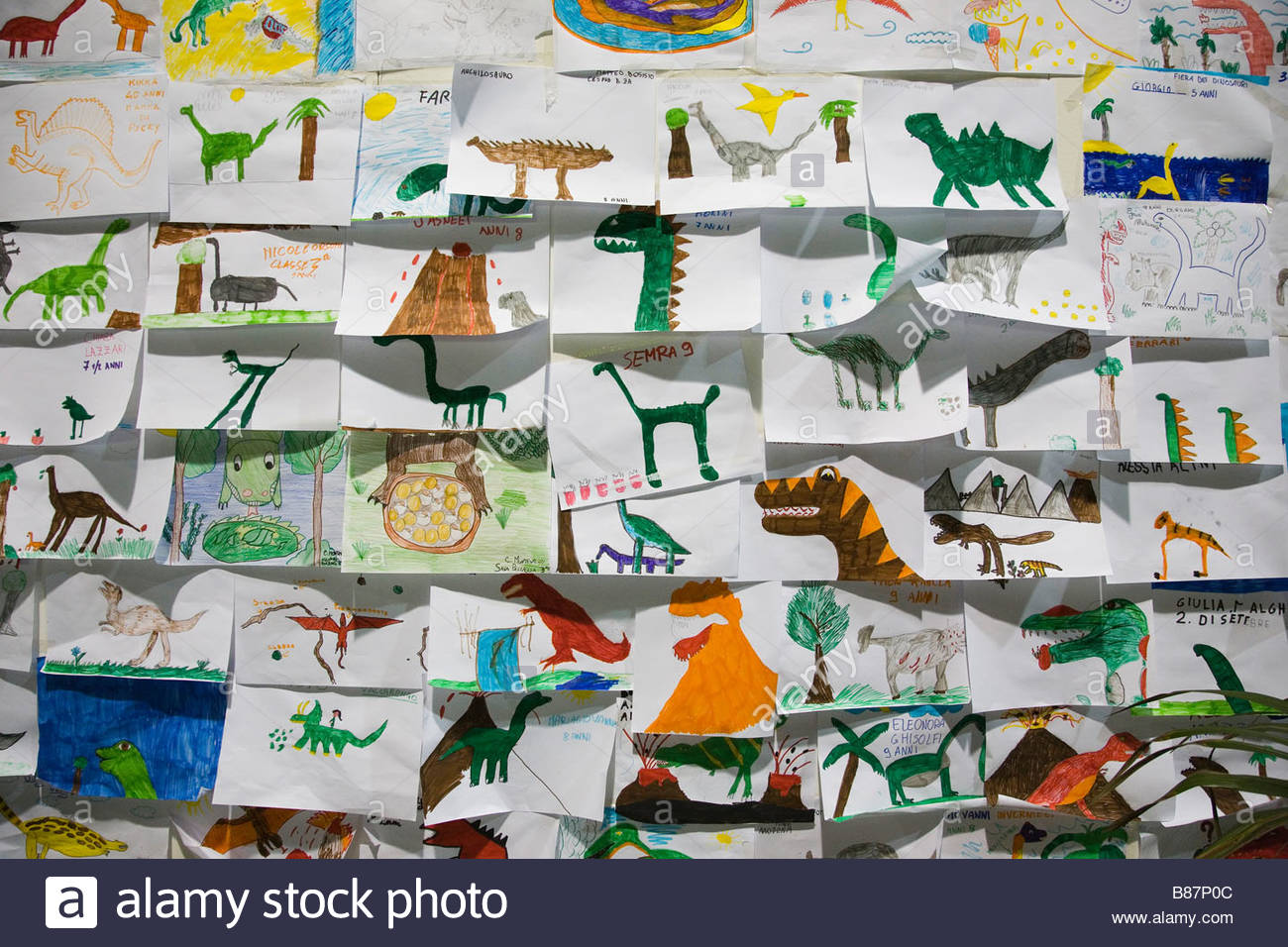 europe,italy,lombardia,cremona,exhibition of reproduction of dinosaurs,drawings by the school children - Stock Image