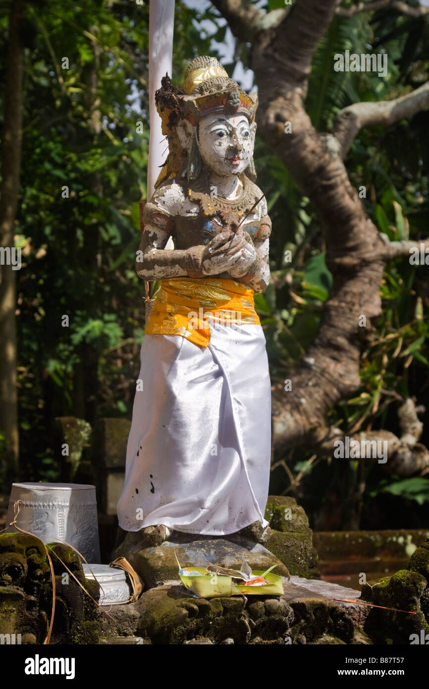 Statue of a Hindu deity in the Trader s Shrine at Rambut Siwi Temple Bali - Stock Image