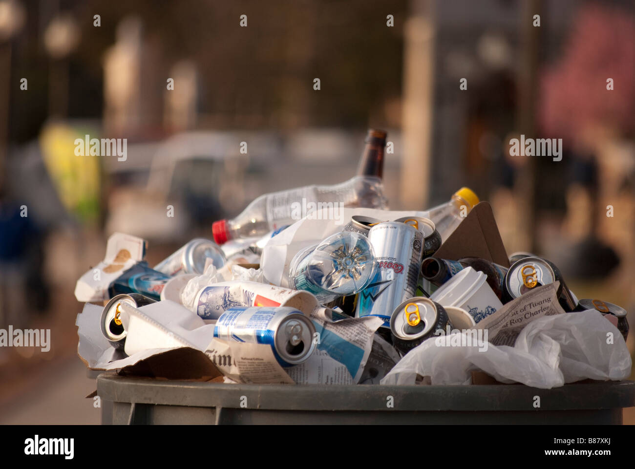 Trash can with empty beer cans in front of Cameron Indoor Stadium the morning after the game Duke University vs - Stock Image