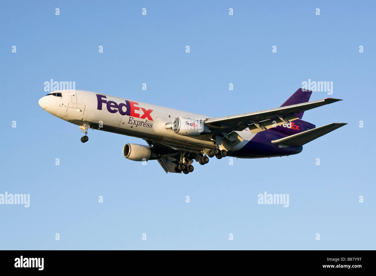 A FedEx MD11 freighter on finals - Stock Image