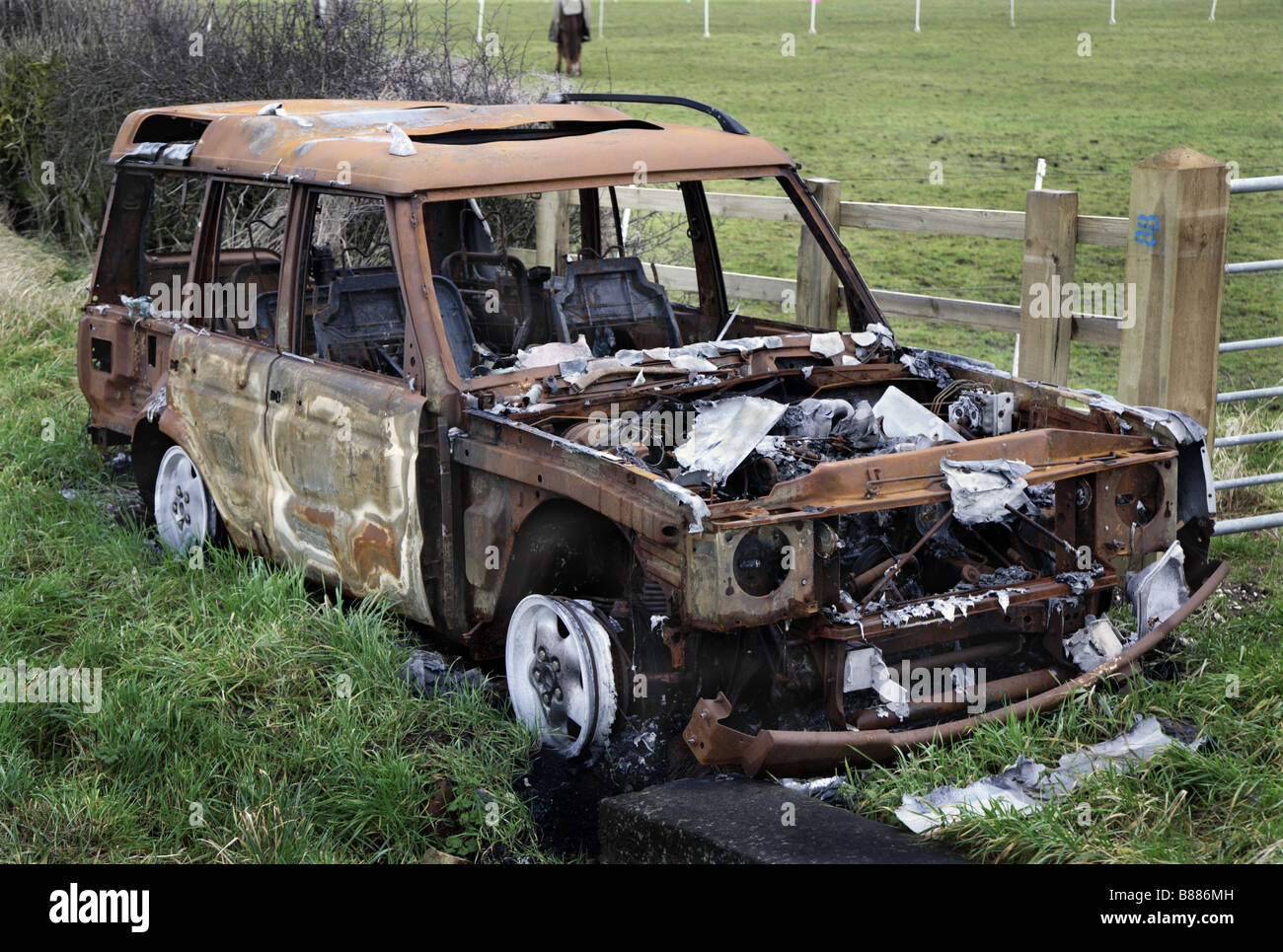 Burnt-out motor vehicle - Stock Image