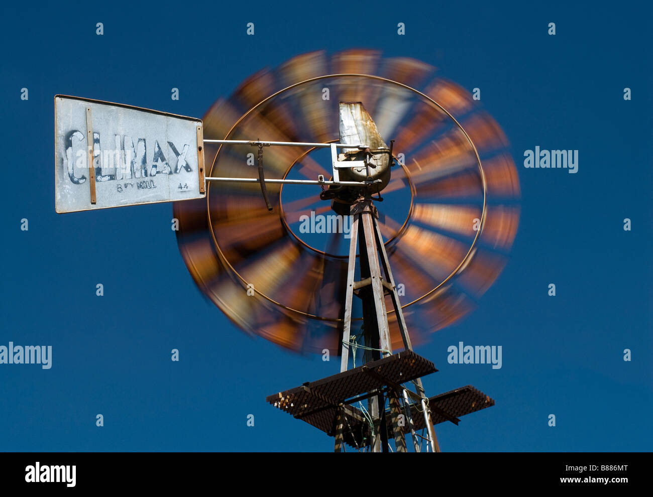 A common sight in drought areas of South Africa, a windmill turning in the wind in the Magaliesberg Mountains - Stock Image