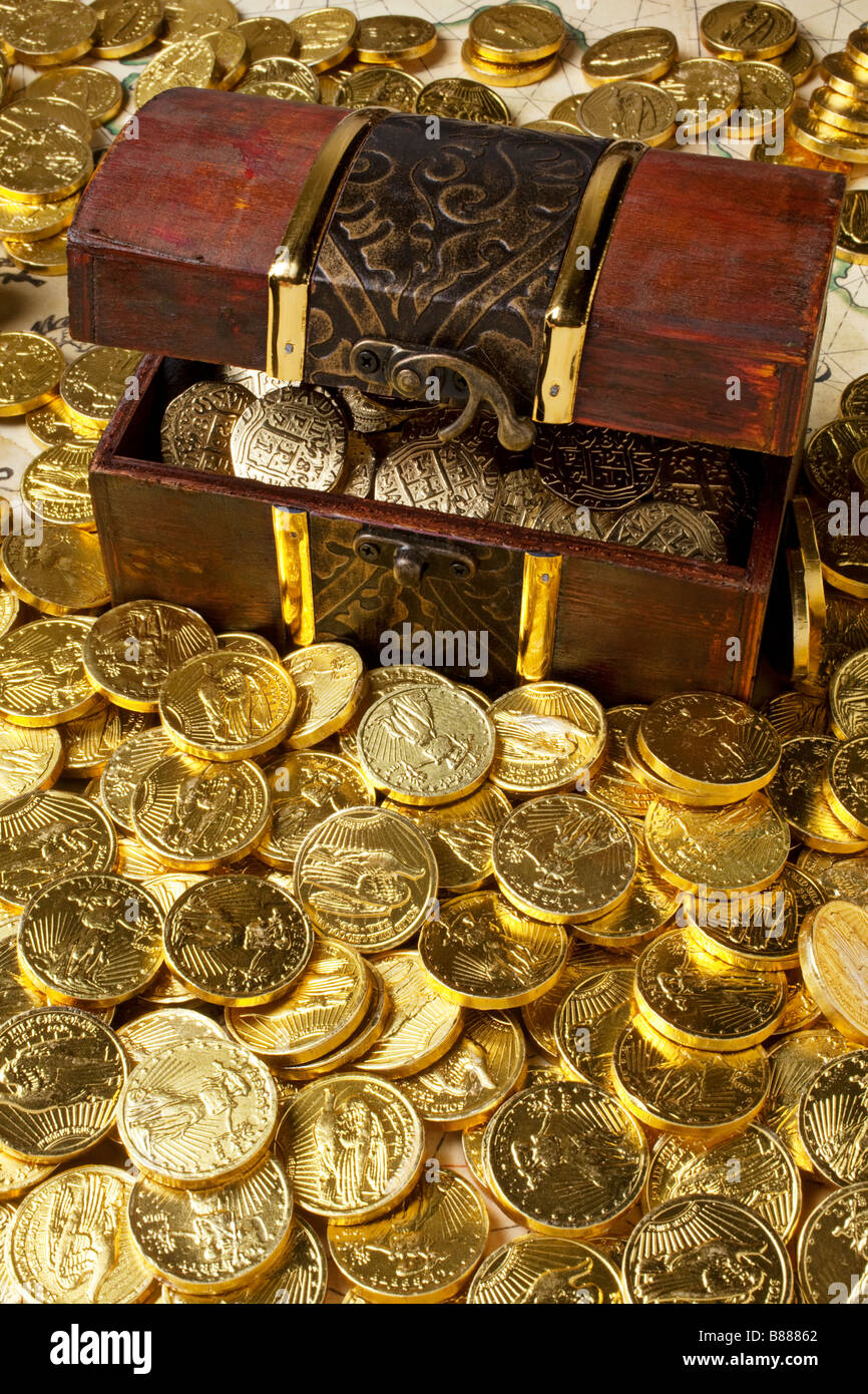 Gold box and gold coins - Stock Image