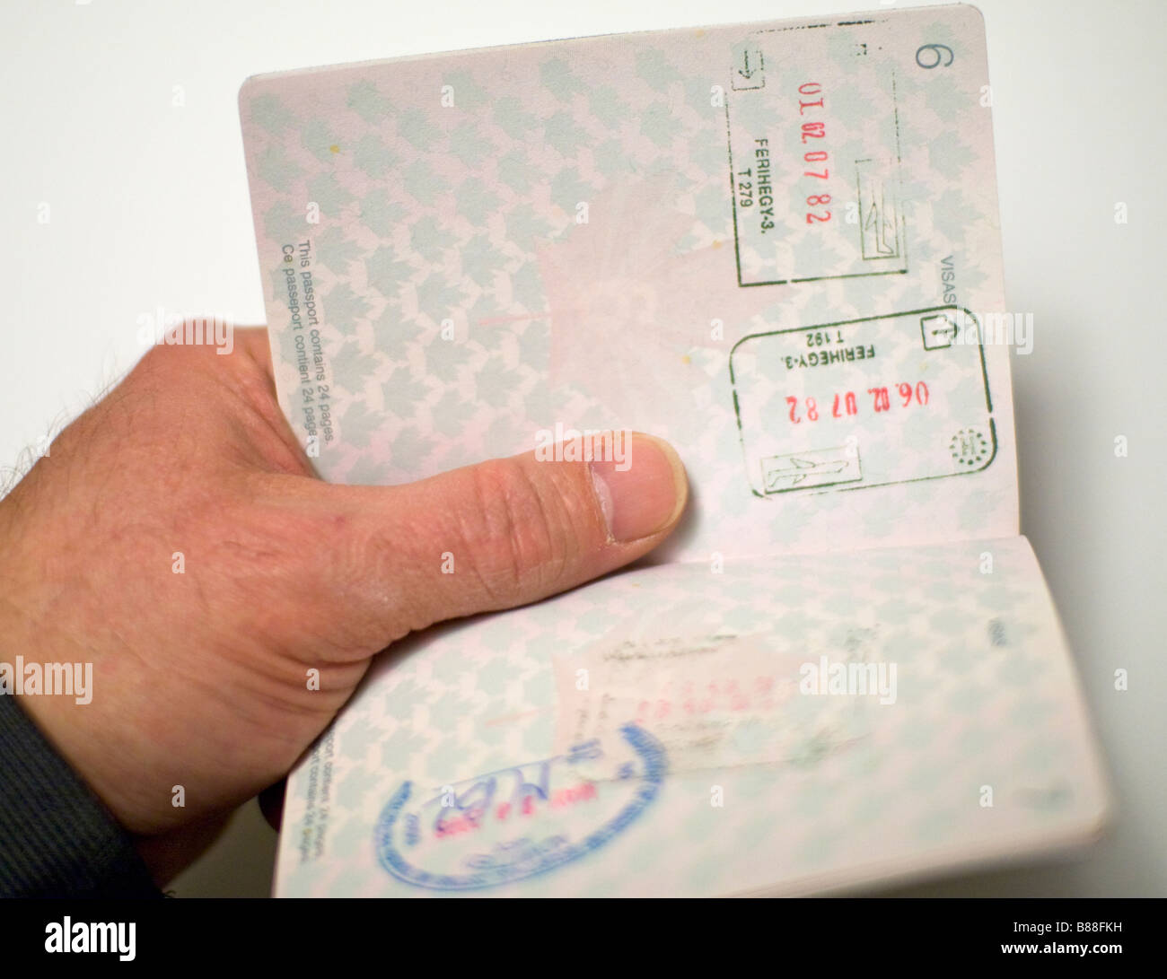 Canadian passport opened for inspection - Stock Image