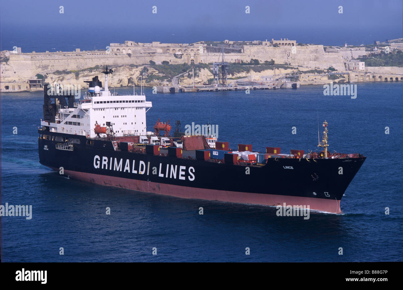 Grimaldi Lines Cargo or Container Ship in the Grand or Great Harbour or Harbor of Valletta, Malta Stock Photo
