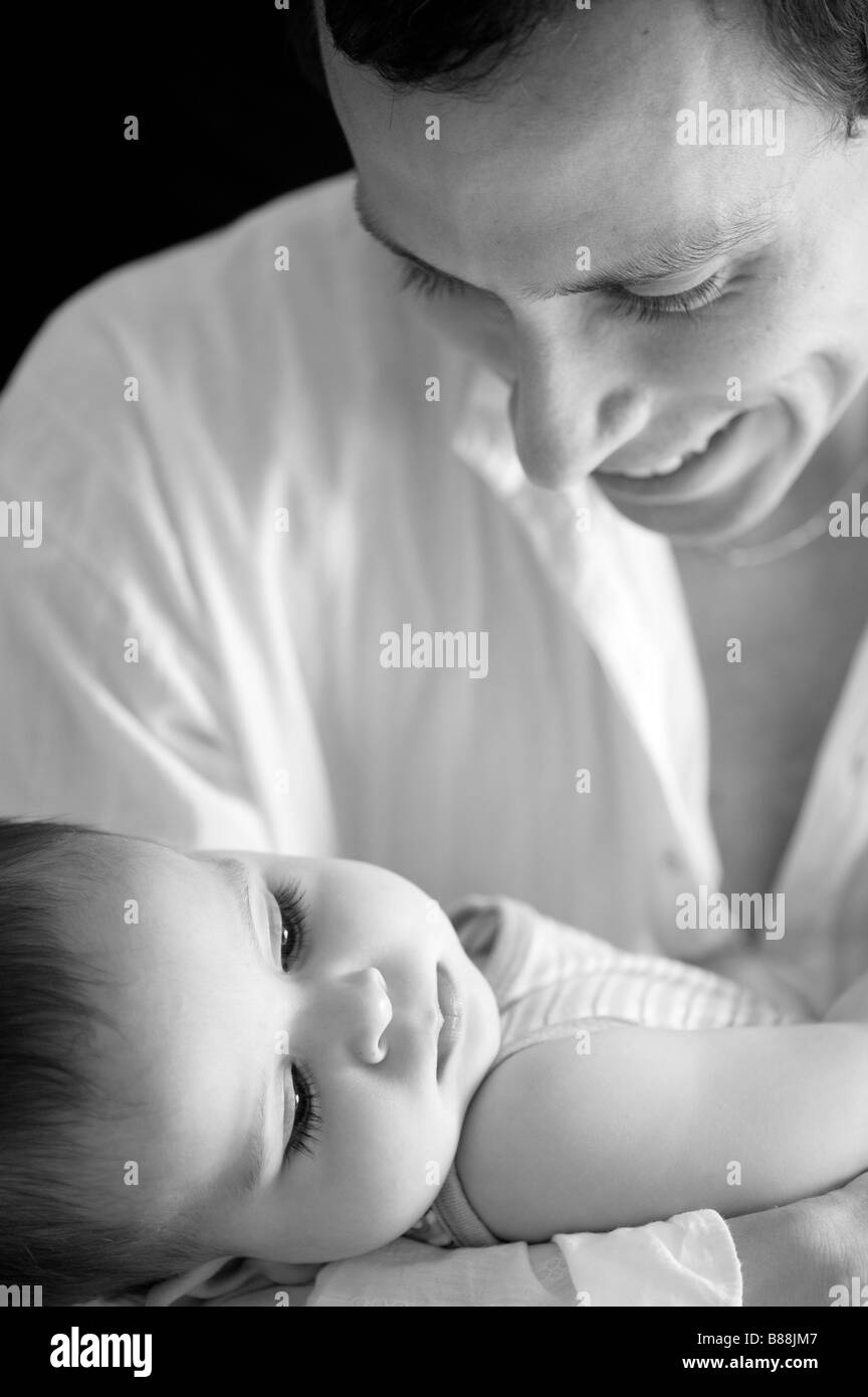 Loving father and baby boy. Black and White - Stock Image