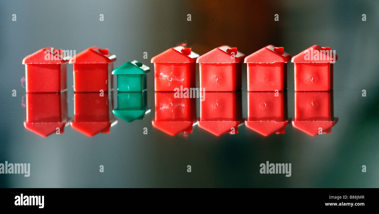 Row of small plastic model houses and hotels, from a popular board game. Stock Photo