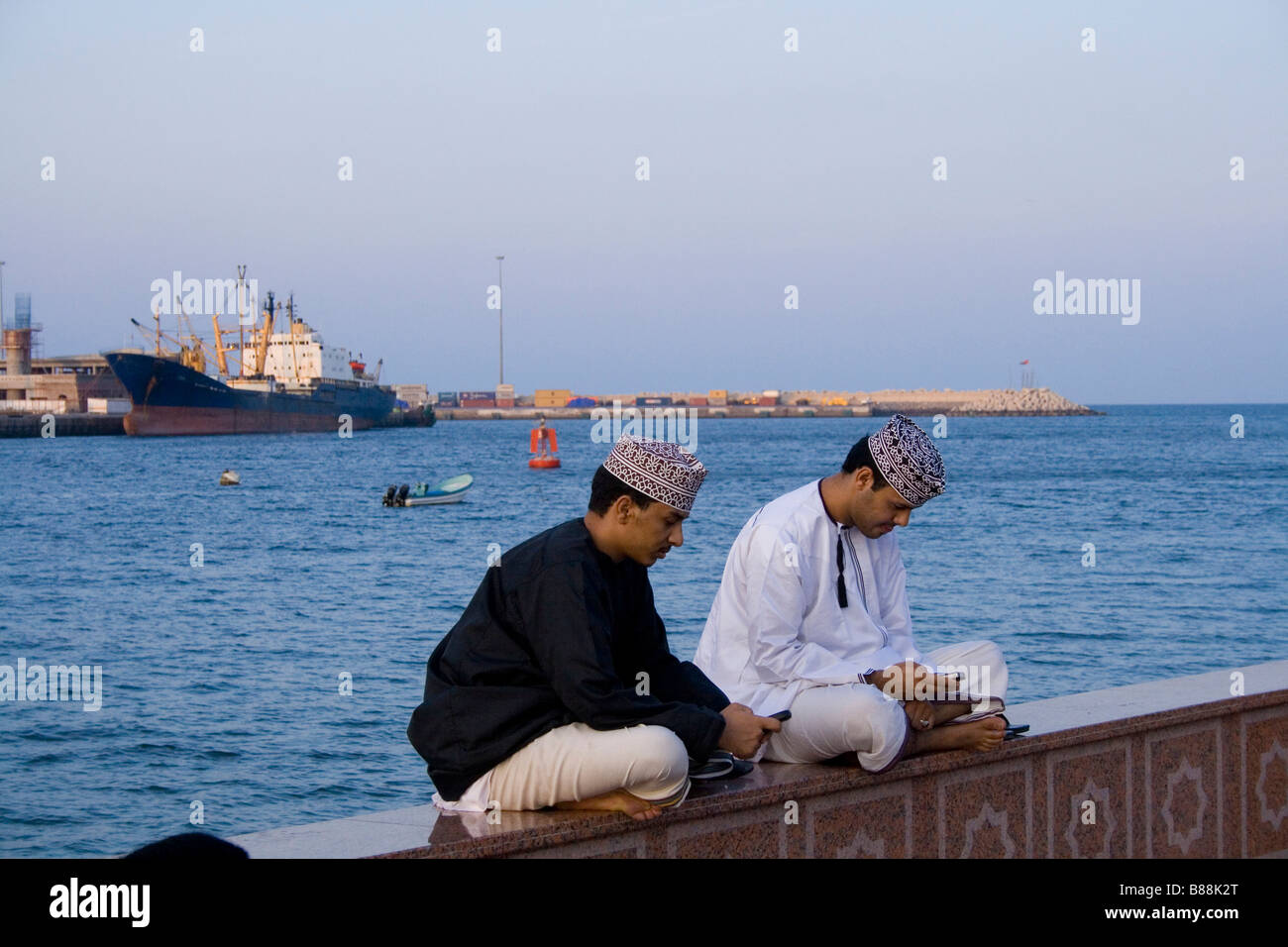 Sending sms at the waterfront boulevard in Muscat the