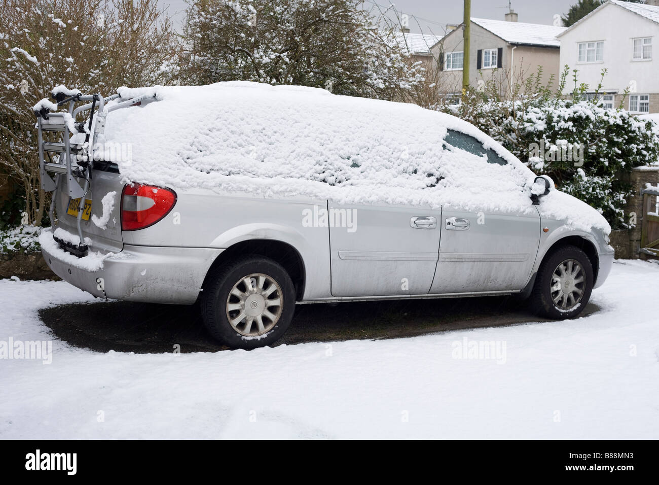 Nobody is going cycling or indeed anywhere on this snowy day when the Chrysler grand voyager remains parked on the Stock Photo