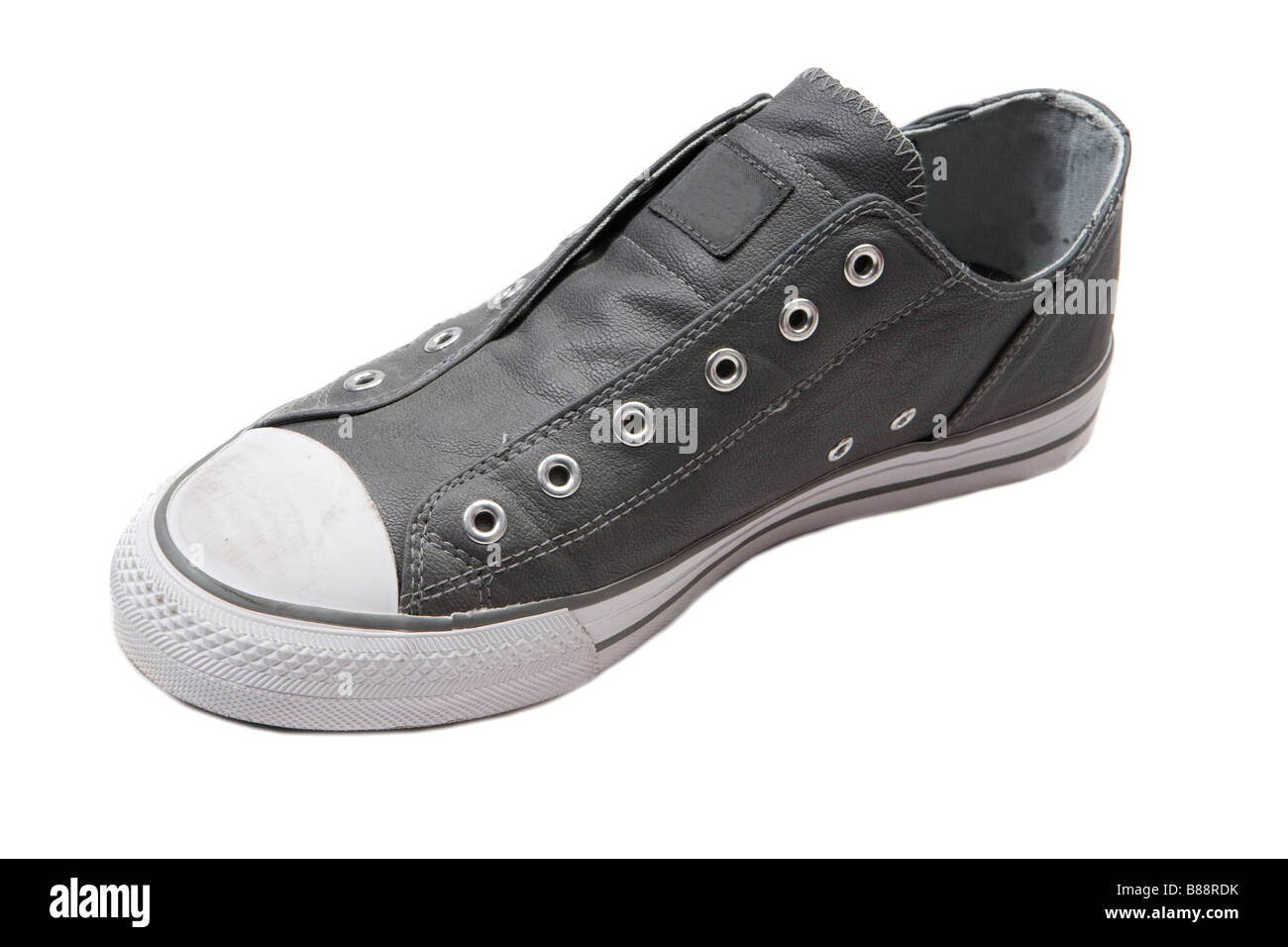 Grey sneaker on a over white background - Stock Image