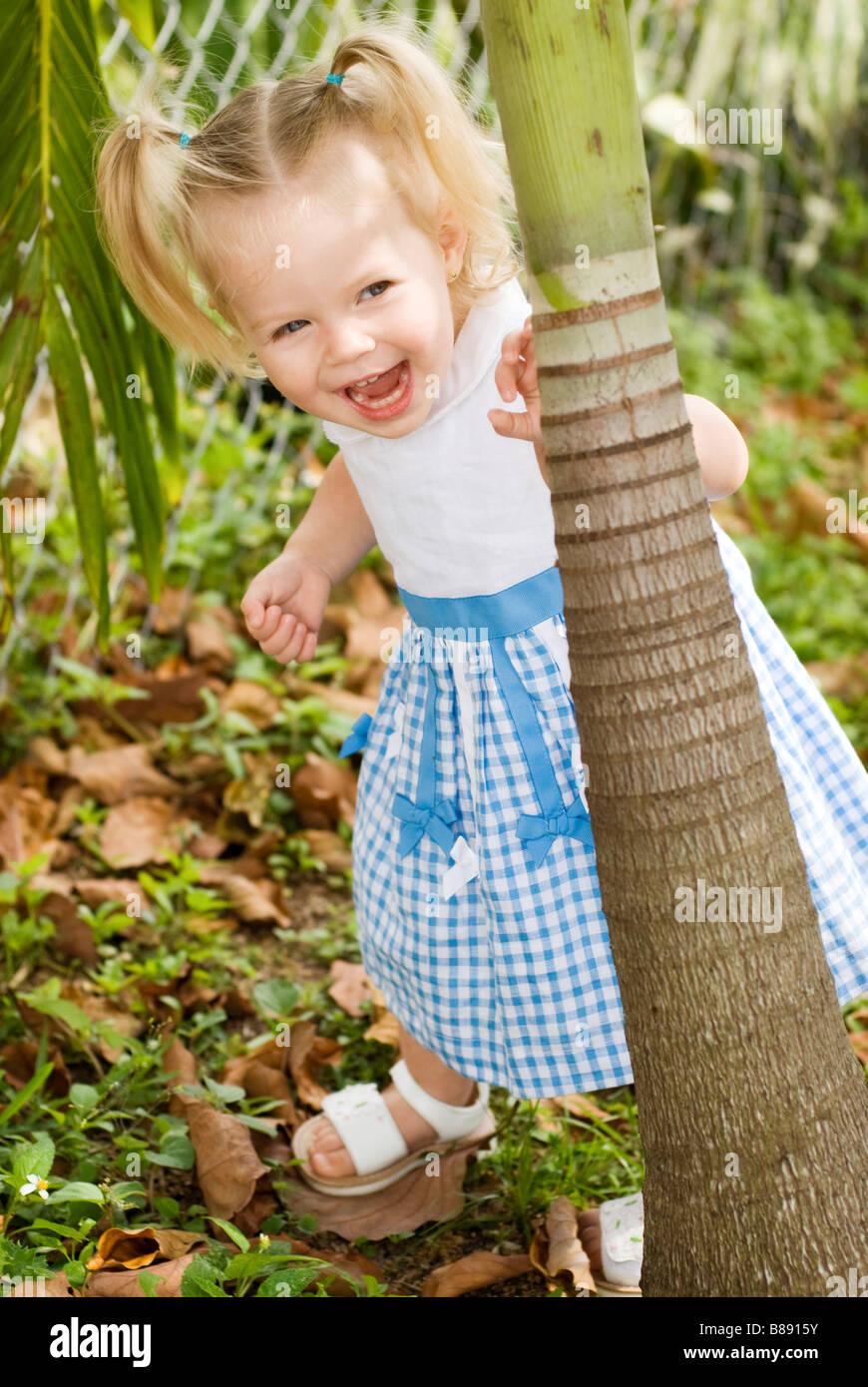 little girl playing hide & seek - Stock Image