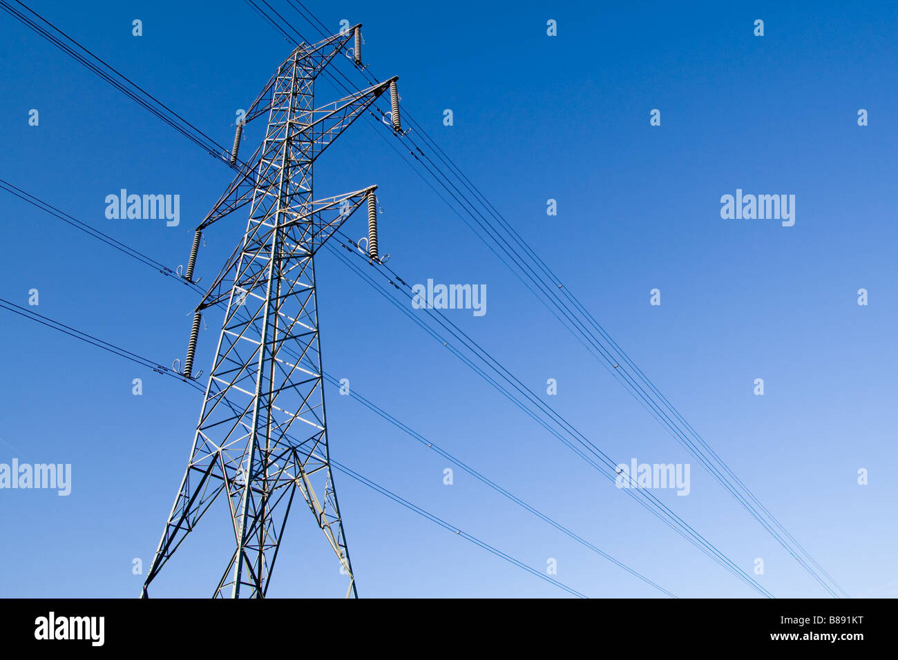 Electricity pylon with clear blue sky background - Stock Image