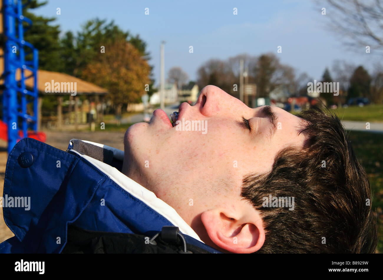 Teen resting outdoors - Stock Image