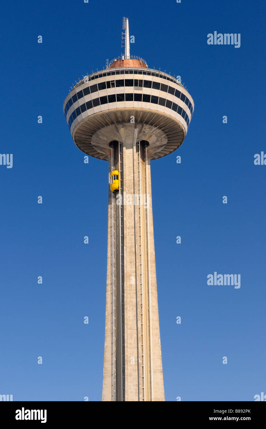 Ride to the top of the Skylon Tower at Niagara Falls Canada against a blue sky - Stock Image
