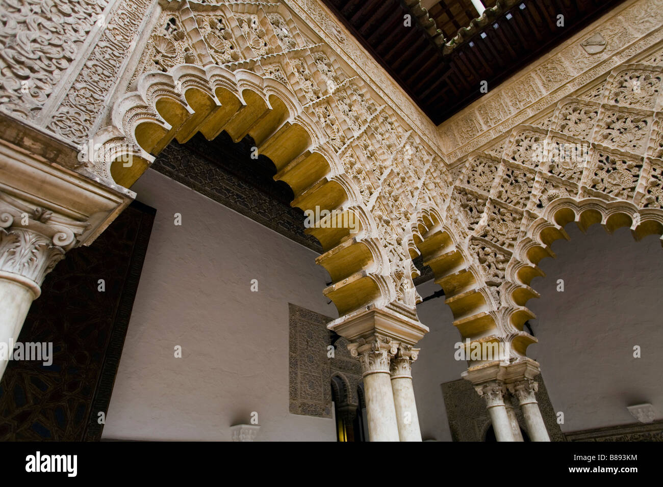 Architectural detail inside the Alcazar a Moorish inspired palace in Seville Spain - Stock Image