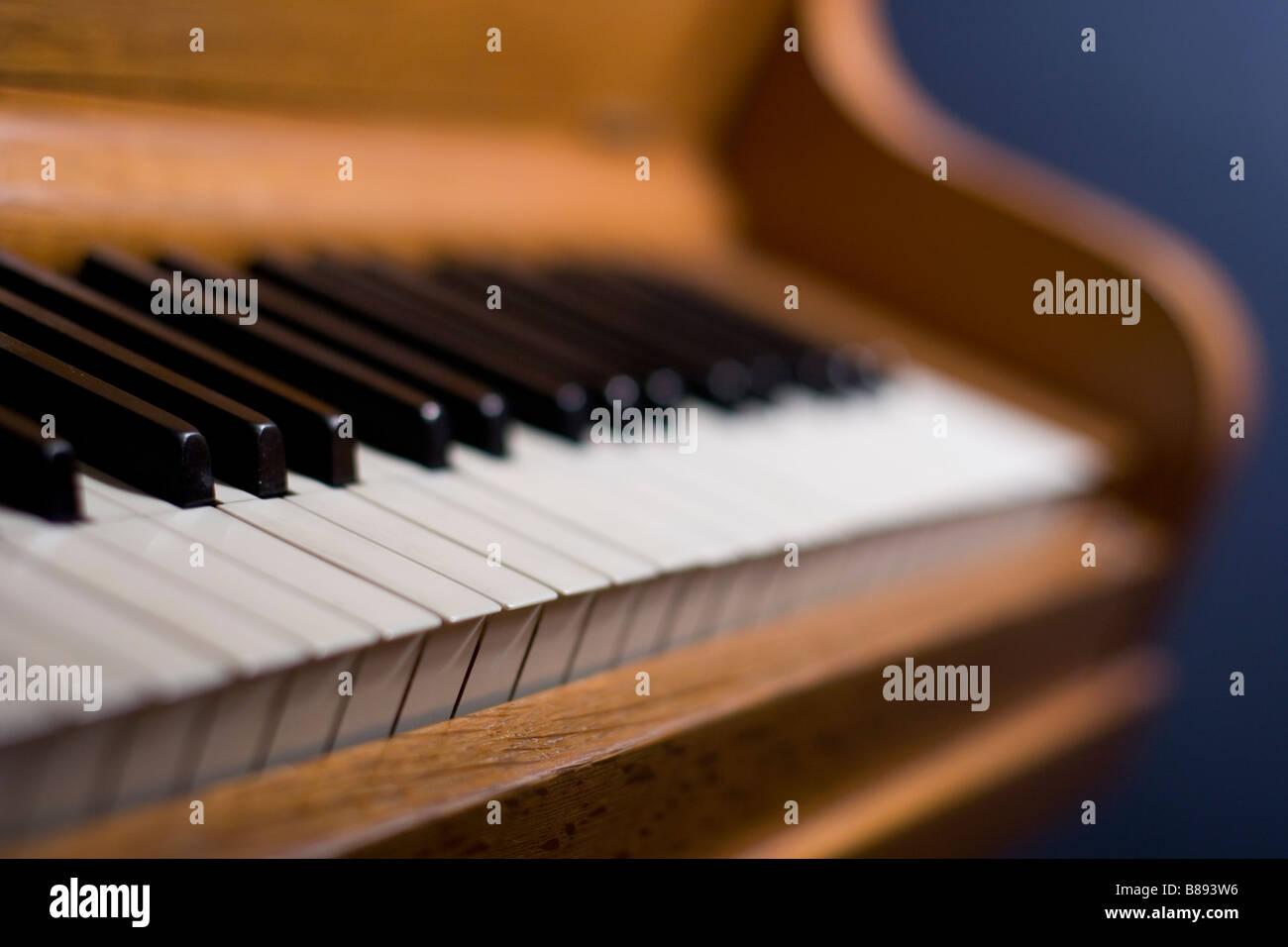 Piano narrow focus point on keys, single lamp as light source - Stock Image
